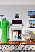 Cactus coat stand next to antique mantelpiece in living room