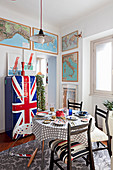 Retro fridge with Union-Flag front and framed maps in dining room