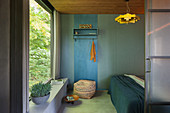 Blue cloakroom panel in room with panoramic window and sliding door