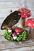 Small New Year arrangement: fly agaric ornaments in silver caviar dish