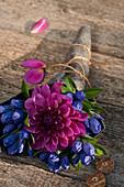 Closed Gentiana with dahlia blossom made into a bouquet
