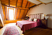 An attic bedroom with a double bed