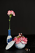 Modern arrangement of carnations and laurustinus flowers