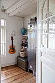 Grey locker, shelves and guitar on wall in Teenager's bedroom