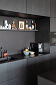Fitted kitchen with dark cabinets