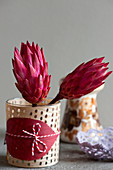 Protea flowers in decorated jar
