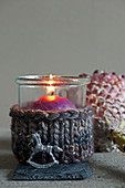 Candle lantern with knitted cover and tiny rocking horse decoration
