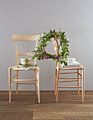 Wreath of leaves on chair backrest