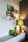 Vases and table lamp on low sideboard