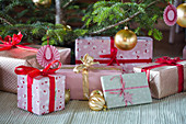Handmade Christmas-tree decorations and wrapped gifts