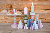 Painted cake stand, candlesticks and paper trees in pastel shades