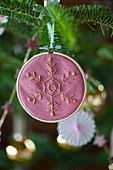 Christmas-tree decoration: embroidered snowflake in small embroidery frame