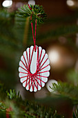 Christmas-tree decoration handmade from paper and yarn