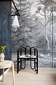 A designer chair in front of motif wallpaper