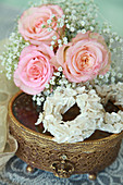 Posy of roses and gypsophila and circlet of seashells