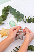 Tying glass stars to eucalyptus star
