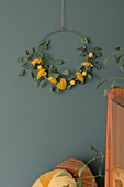 Wreath of eucalyptus twigs, yarrow and yellow felt balls