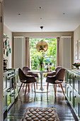 A 1960s style kitchen with a dining area in a Victorian house