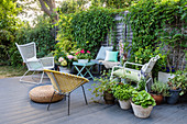Garden furniture on decking with pot plants