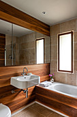 Bathroom with walnut cladding