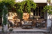 Rattan furniture on a green veranda