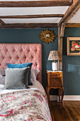 A 1930s Art Deco-style bedroom with exposed beams
