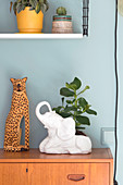 Leopard figurine and small rubber plant in elephant planter