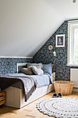 A girl's room in grey-blue tones in the attic