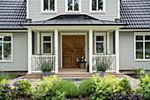 The entrance of a wooden Scandinavian house