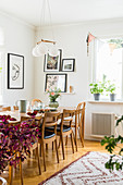 Table and chairs below pendant lamp in dining area