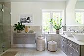 A spacious bathroom in grey tones