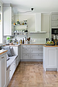 A bright, spacious kitchen with grey cabinet fronts