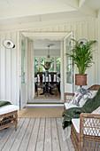 Rattan furniture on covered wooden veranda