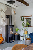 A wood-burning stove in a rural-style living room
