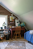 A guest room with desk in the attic