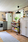 A kitchen trolley in a rural-style kitchen