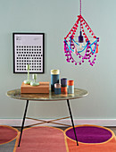 A DIY hanging lamp with vintage pompoms and tassels