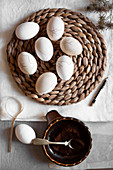 Easter eggs dyed with coffee and decorated with eyeliner pencil