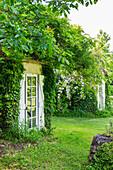 Hidden entrance with glass door in the garden