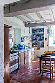 Rustic kitchen with wooden beams and terracotta tiled floor