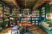 Library with green accents and rustic wooden beams