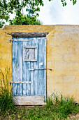 Outbuilding with wooden door