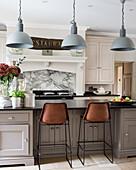 Pendant lights above kitchen breakfast bar