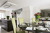 Open plan kitchen dining room with highback upholstered chairs