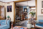 Arts and Crafts style revolving bookcase and storage in drawing room