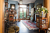 Arts and Crafts style revolving bookcase in drawing room of Victorian terrace