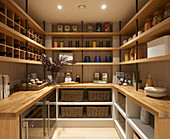 Well-organised pantry in modern country-house style