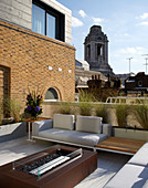 Modern lounge furniture and gas fireplace on roof terrace