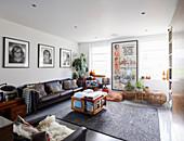 Leather sofas in bright retro living room