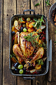 Autumn roasted chicken with grapes and apples